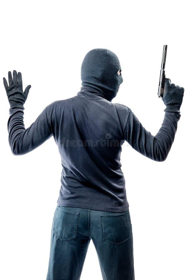Misdadige die terrorist met handen omhoog op wit wordt geïsoleerd stock foto