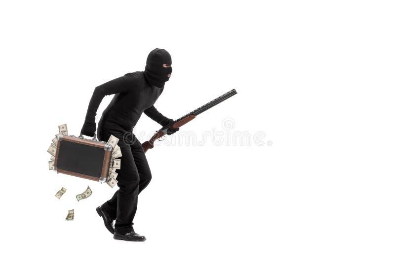 Misdadiger met aktentashoogtepunt van gestolen geld royalty-vrije stock foto