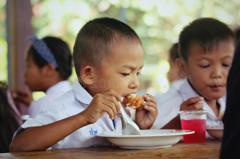 Miserable children beggarly disadvantaged Child homelessness. Lunch for children merit Child homelessness stock photo