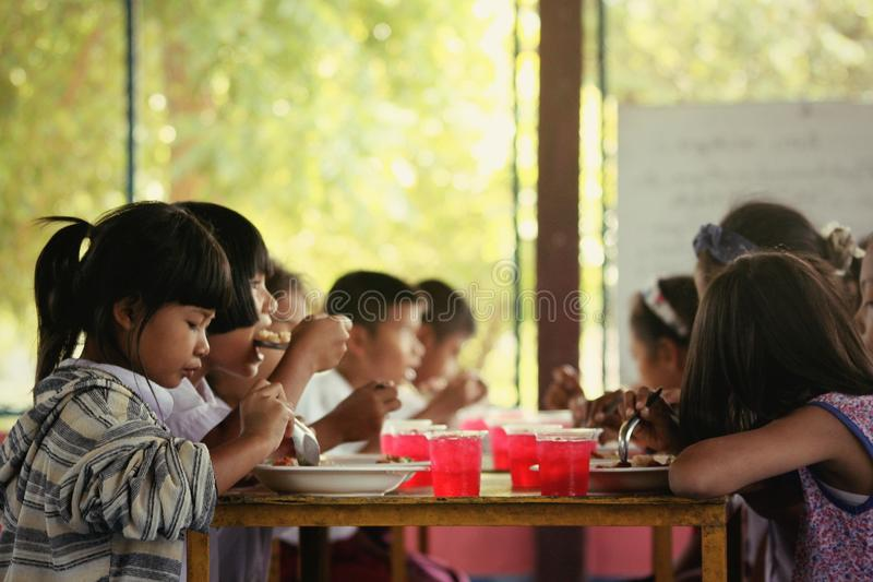 Miserable children beggarly disadvantaged Child homelessness. Lunch for children merit Child homelessness stock photos