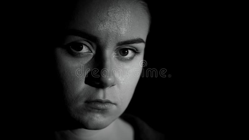 Miserable refugee looking at camera, life troubles, social insecurity, close up. Stock photo stock photography