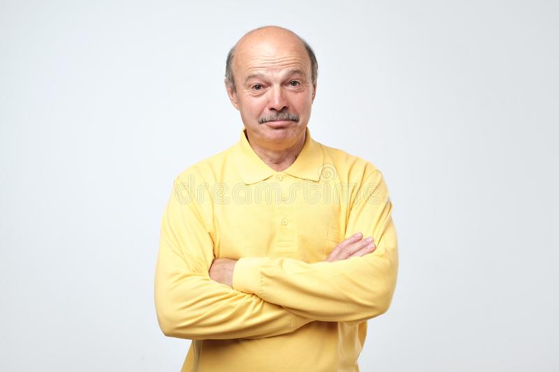 Miserable sad mature european man being offended and upset stock photo