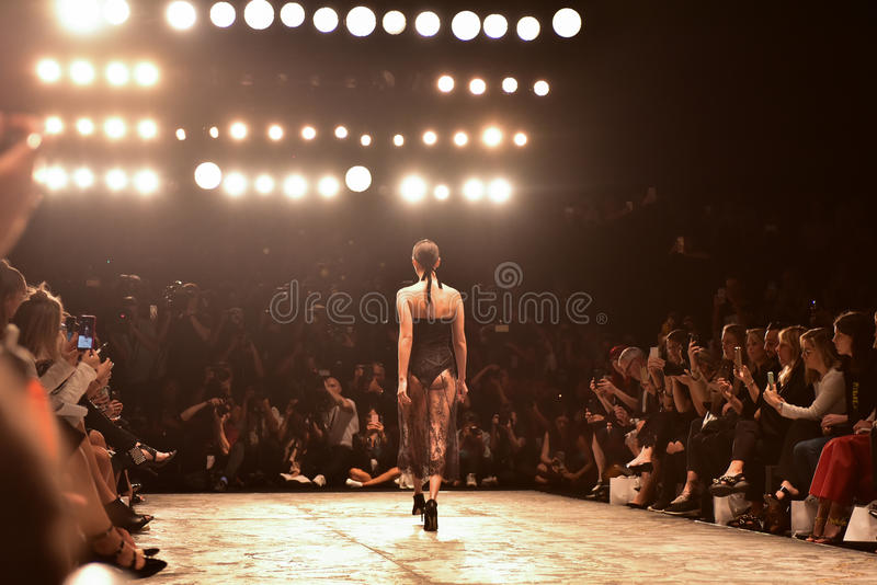 MISHA collection fashion week. SYDNEY / AUSTRALIA - MAY 16: Model walks on runway during lace female MISHA collection fashion show during Mercedes Benz Fashion stock photography