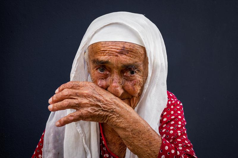 Portrait of an old woman with traditional dress at Misi Village in Bursa, Turkey royalty free stock image
