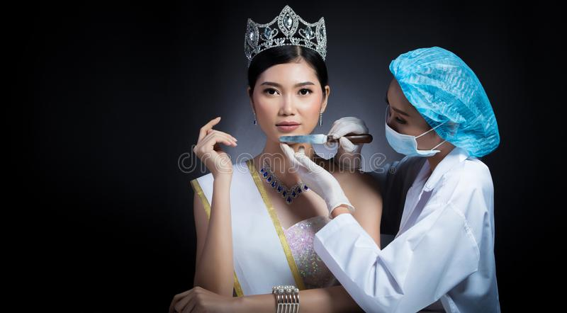 Miss Beauty Queen Pageant Contest with Diamond crown sash is che. Cked up by Beautician Doctor and recommend consult before Plastic Surgery, skin treatment stock photography
