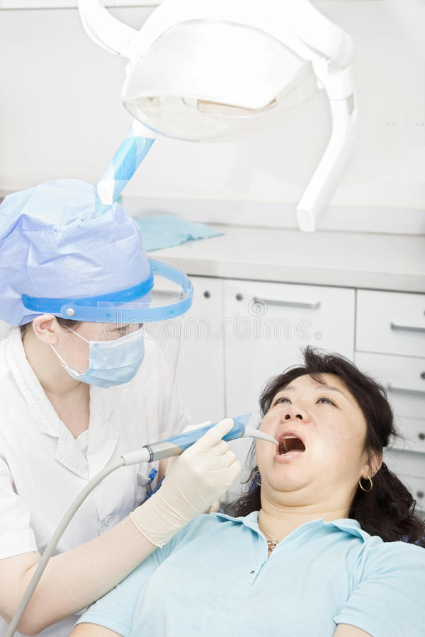 A miss dentist is working stock photo