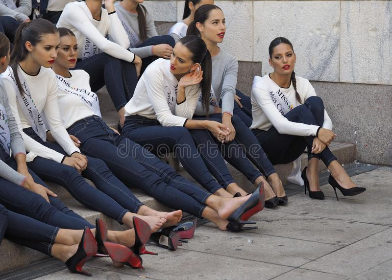 MILAN, Italy: 10 September 2018: Miss Italia models relaxing legs and feet. Miss Italia models relaxing legs and feet on Arengario stairs after photoshoot in stock photography