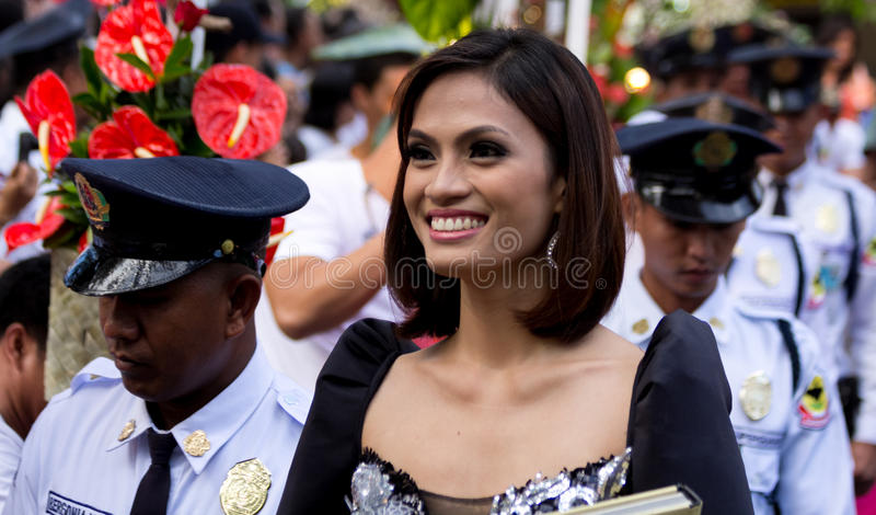 Miss Philippines, Binibining Pilipinas joins Santacruzan in Manila. Metro Manila, Philippines- May 18, 2013: Annual procession practiced by the catholic church royalty free stock image