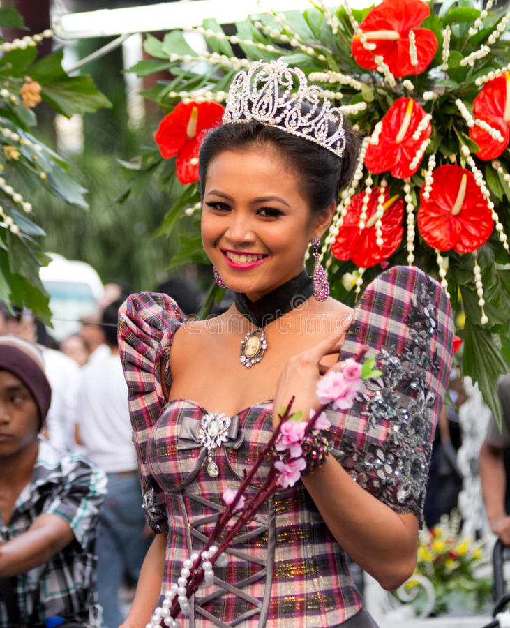 Miss Philippines, Binibining Pilipinas joins Santacruzan in Manila. Metro Manila, Philippines- May 18, 2013: Annual procession practiced by the catholic church stock photography