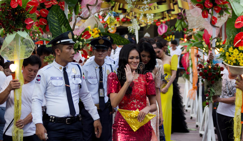 Miss Philippines, Binibining Pilipinas joins Santacruzan in Manila. Metro Manila, Philippines- May 18, 2013: Annual procession practiced by the catholic church royalty free stock photo