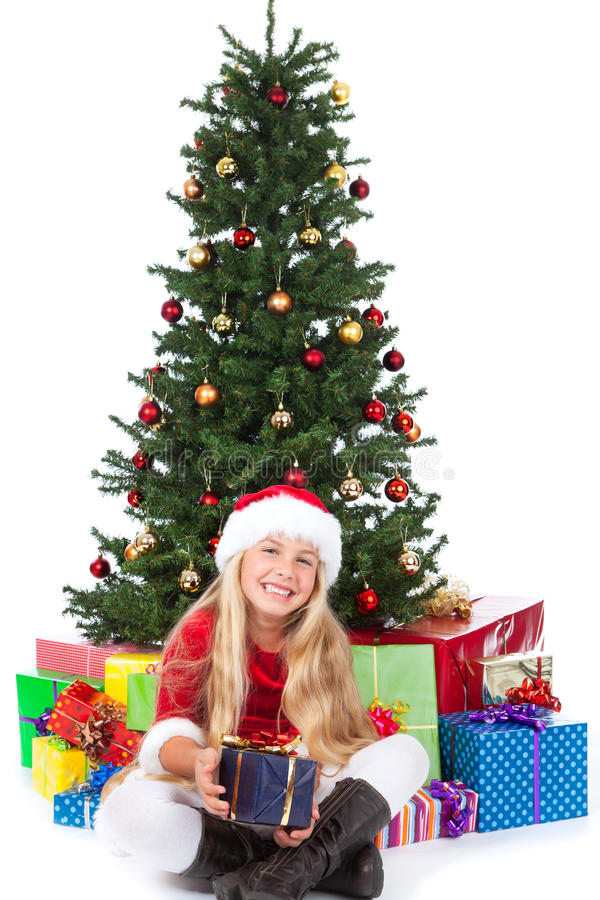 Miss Santa Before Christmas Tree And Gifts Royalty Free Stock Photography
