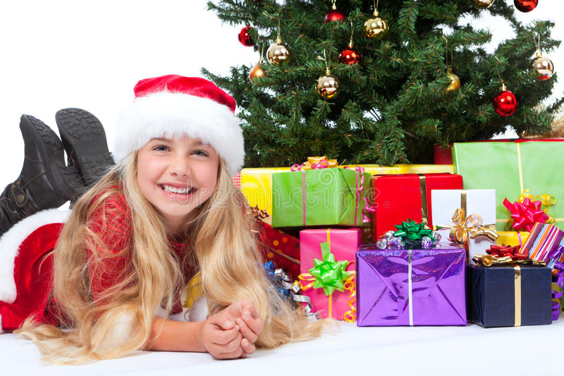 Miss santa before christmas tree and gifts royalty free stock photo