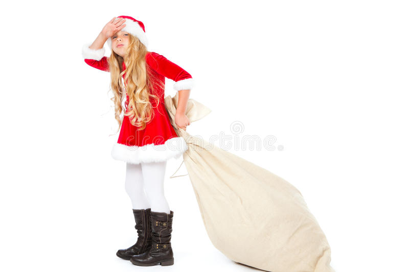 Download Miss Santa Exhausted Of Pulling Heavy Gift Sack Stock Photo - Image: 21758592