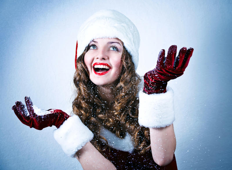 Download Miss Santa Looking At The Snow Stock Photo - Image of december, attractive: 22420512