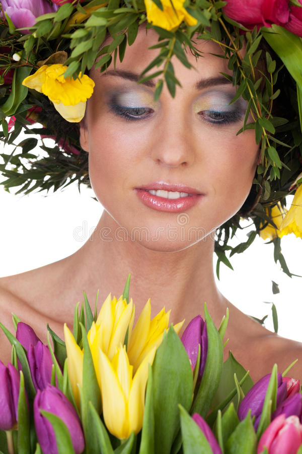 Miss spring. Charming girl with spring flowers on isolated white stock photo