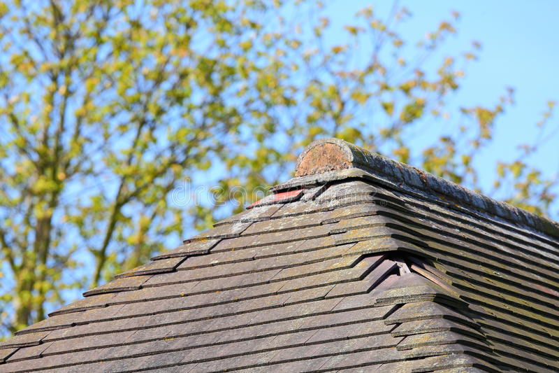 Missing damaged roof tiles stock image