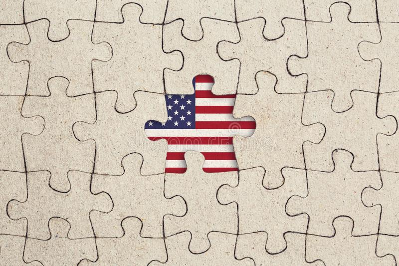 Missing jigsaw puzzle piece and usa flag. Abstract concept stock photography