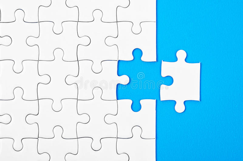 Missing jigsaw puzzle pieces. stock images