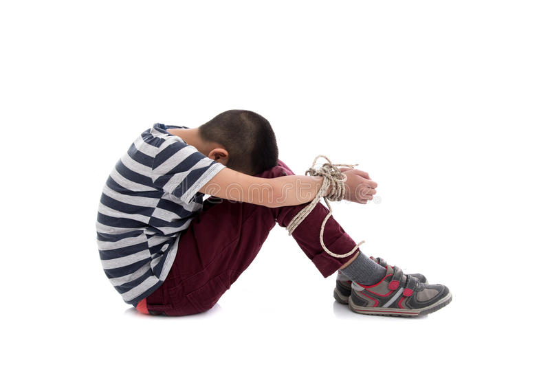 Missing kidnapped, abused, hostage,. Victim boy with hands tied up with rope in emotional stress and pain, afraid, restricted, trapped, call for help, struggle royalty free stock photos