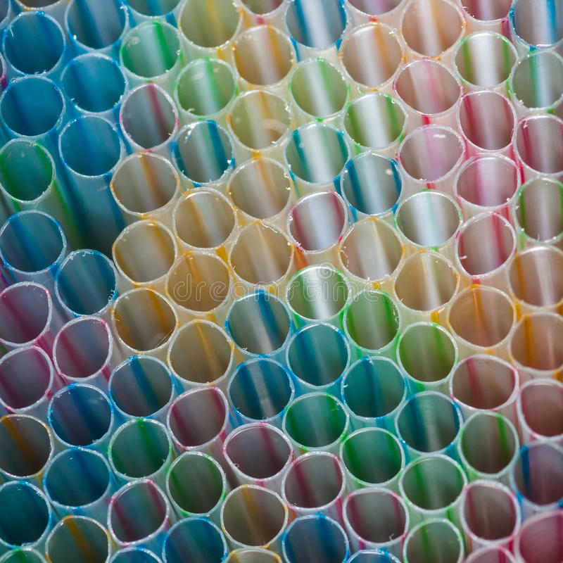 Missing Link. A macro shot of a collection of drinking straws stock photo