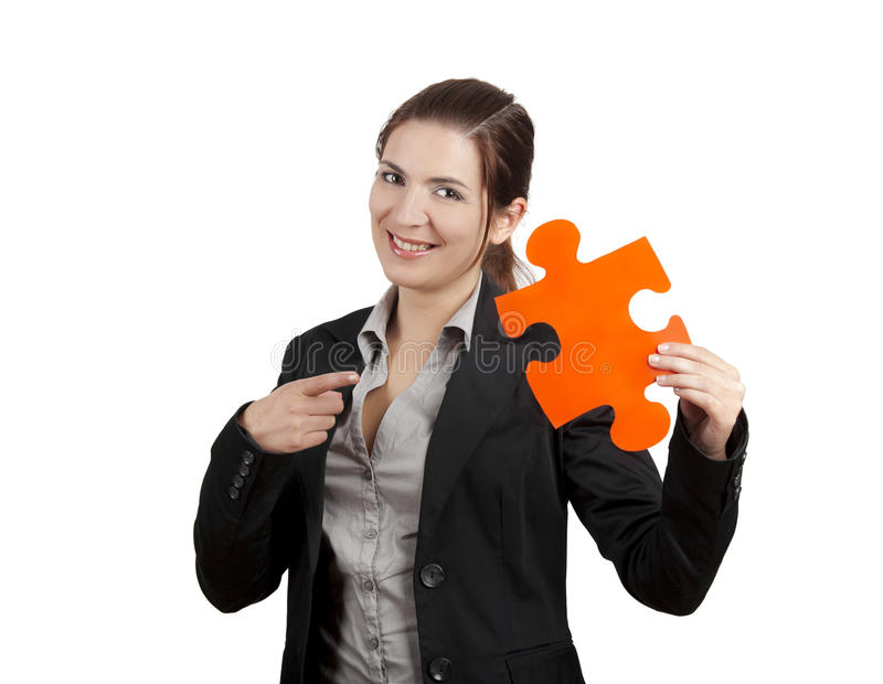 The missing piece. Business woman holding and pointing to a puzzle piece, isolated on white stock photos