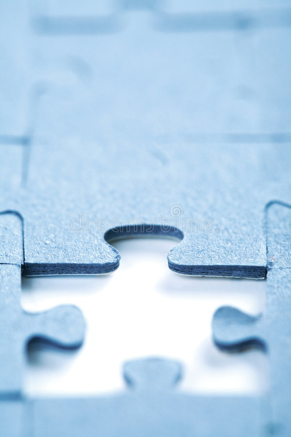 Missing piece. Of jigsaw. Focus on the upper part of the hole royalty free stock photography
