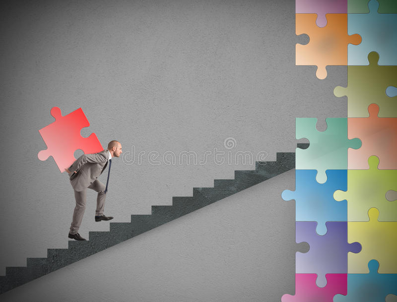 Missing piece of puzzle of a businessman build a new company stock photography