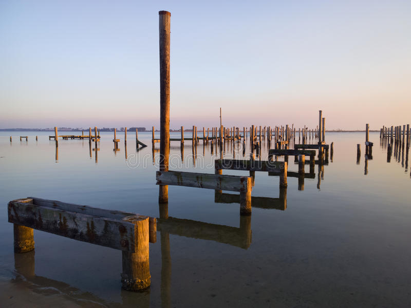 Missing Piers. Remains of piers on Gulf Coast near Biloxi, MS ten years after Hurricane Katrina stock image