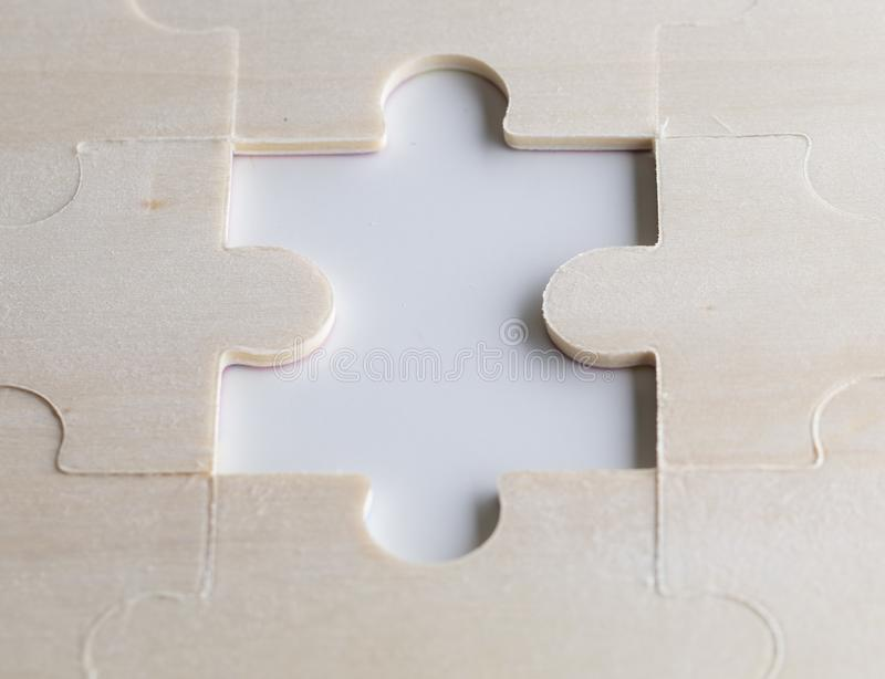 Missing puzzles on a wooden background. Concept business. Idea:. Working in a team. Close up royalty free stock photography