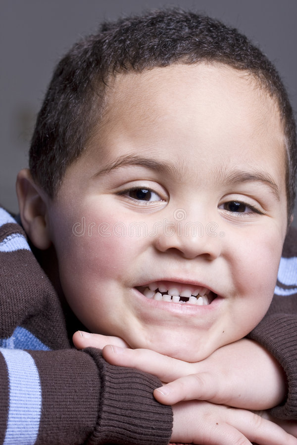 Missing tooth. Young boy with missing baby tooth smiling royalty free stock photography