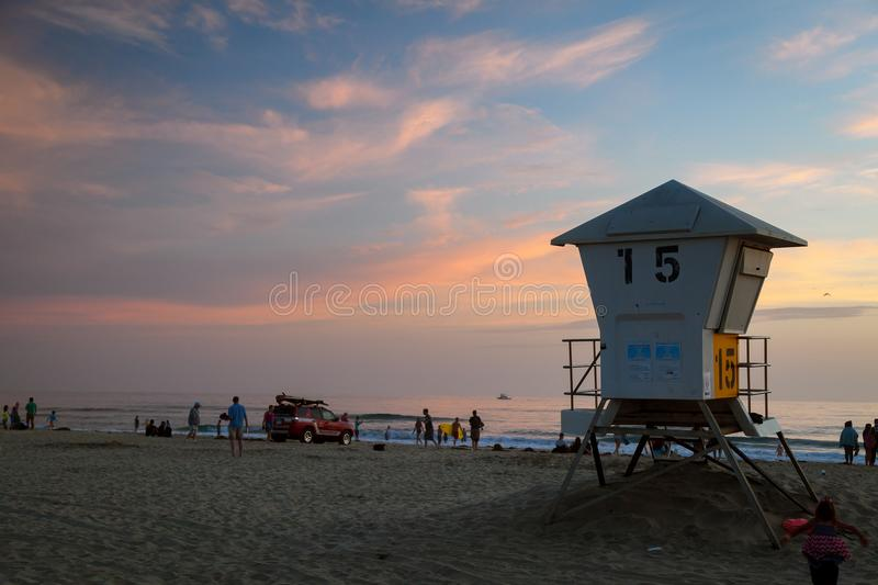 MISSION BAY, CA-USA-8 JULY 2018- Sunset at Mission Bay Beach. L. Ifeguard tower 15 in the foreground with a Lifeguard truck on the beach. Lifeguards are leaving stock photography