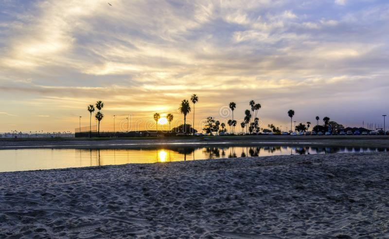 Mission Bay, San Diego, California. The sunrise over Sail bay in Mission Bay over the Pacific beach in San Diego, California in the United States of America. A stock photo