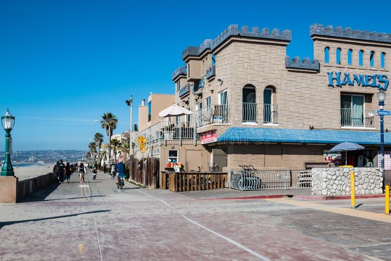 Mission Beach Boardwalk in San Diego, California. SAN DIEGO, CALIFORNIA - FEBRUARY 9, 2018: The Mission Beach boardwalk, a concrete walkway measuring a total stock images