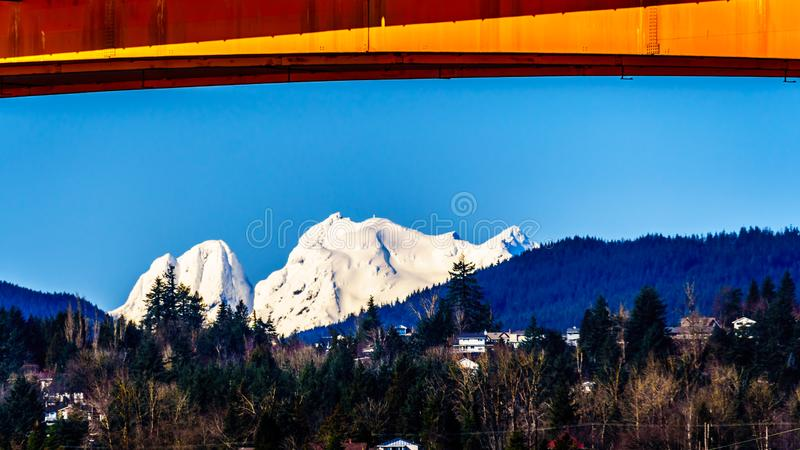 Mission Bridge over the Fraser River on Highway 11 between Abbotsford and Mission with snow covered Mount Robie Reid royalty free stock photos