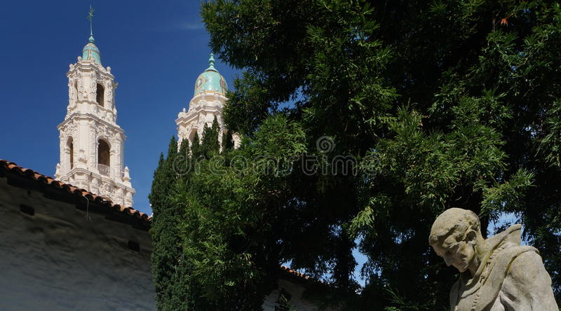 Mission Dolores. Completed in 1791, is the oldest building in San Francisco. The picture is taken from the cemetary with the scuplture of on of the monks in royalty free stock photo