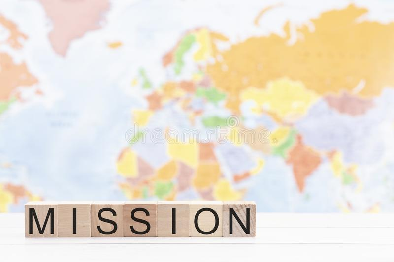 Mission Spelled in Blocks Against a Background of a World Map royalty free stock photo