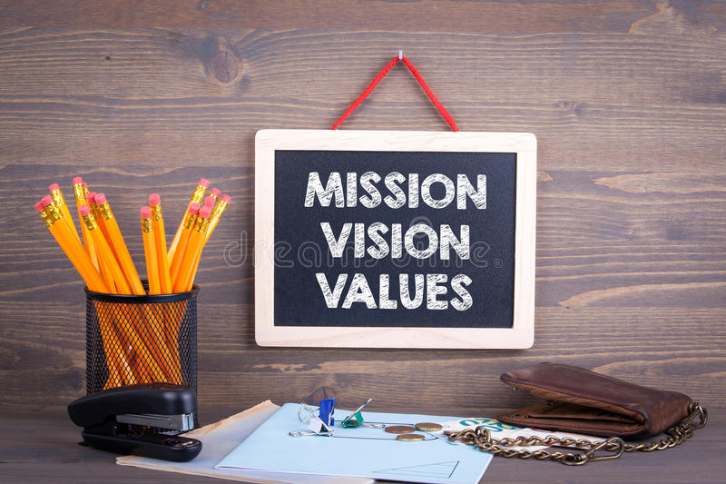 Mission, Vision and Values. Chalkboard on a wooden background.  royalty free stock photo