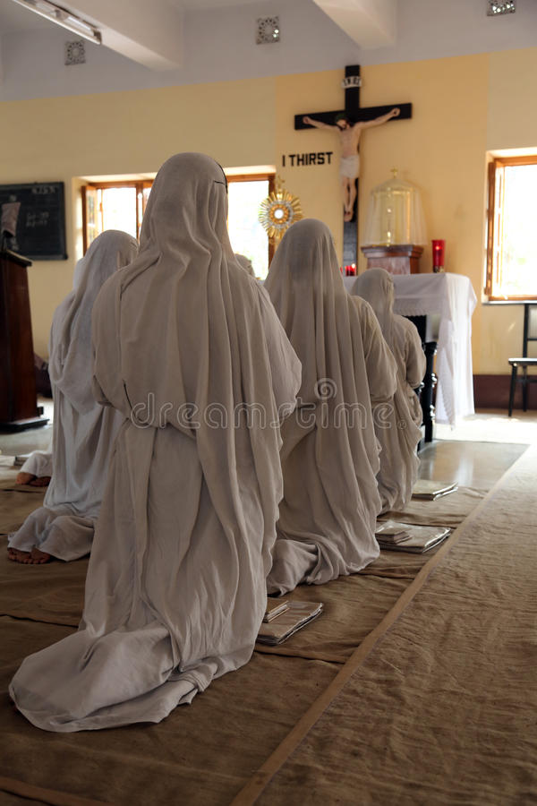 Missionaries of Charity in the chapel of the Mother House, Kolkata. KOLKATA, INDIA - FEBRUARY 08: Sisters of Mother Teresa's Missionaries of Charity in prayer in stock images