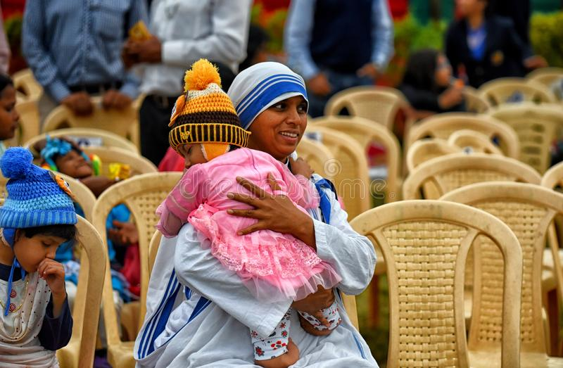 Missionaries of Charity with the Orphan. Sisters from The Missionaries of Charity which takes care of abandoned children visited he Vijay Diwas show at Kolkata royalty free stock photo