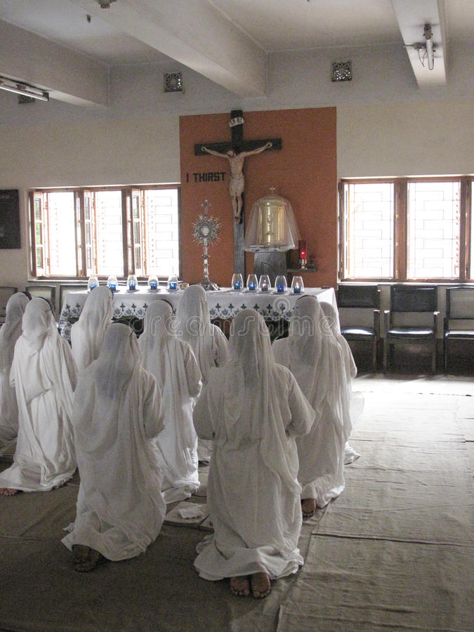 Missionaries of Charity in prayer. Sisters of Mother Teresa's Missionaries of Charity in prayer in the chapel of the Mother House, Kolkata, India at January 27 stock images