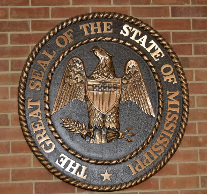 Mississippi Great Seal on Brick. Great Seal of the State of Mississippi on brick background, Mississippi is a state in the Southern United States, with part of royalty free stock photos
