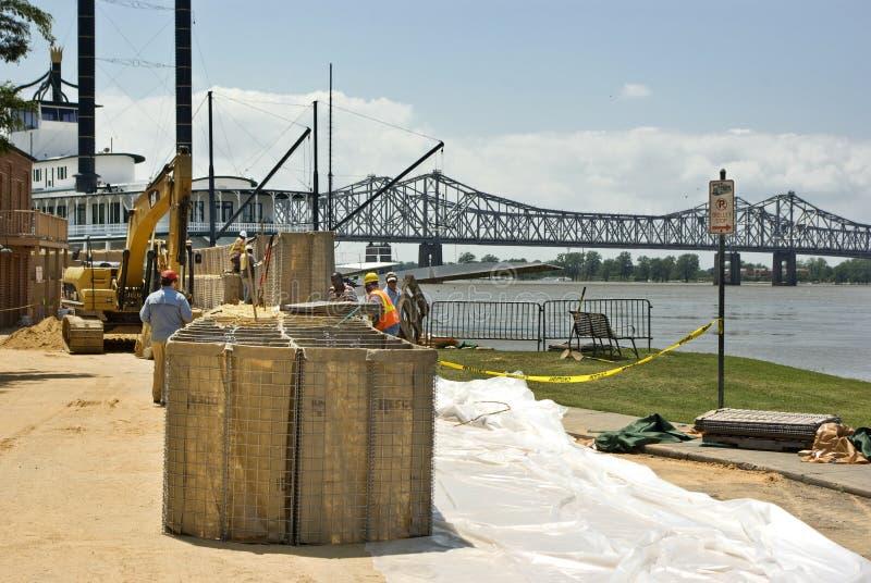Mississippi River flood preparation. Mississippi River, Natchez, Mississippi, taken 5-8-11. HESCO baskets, the modern version of sandbags, are filled and stacked royalty free stock photo