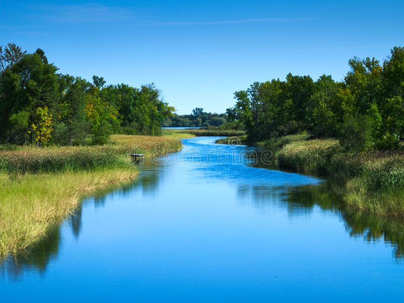 Beautiful Mississippi River flows north toward Bemidji Minnesota. Mississippi River flows north toward Bemidji Minnesota near hiway 2. This scene is a few miles royalty free stock images