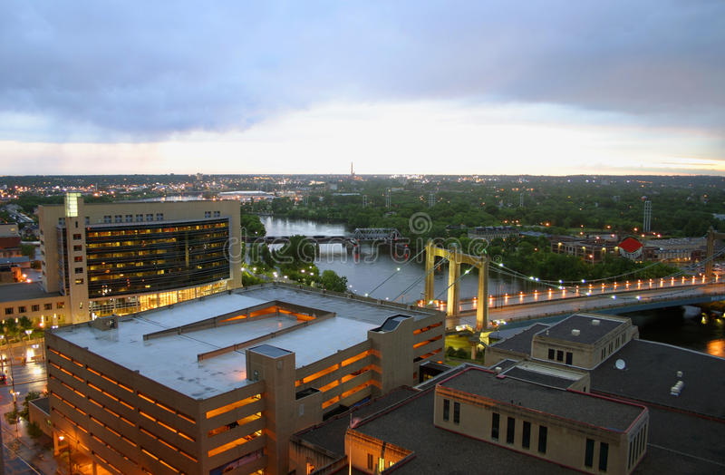 Mississippi River in Minneapolis. A view of the Mississippi River with downtown buildings in the foreground and the Hennepin Avenue Bridge in Minneapolis at dusk royalty free stock images