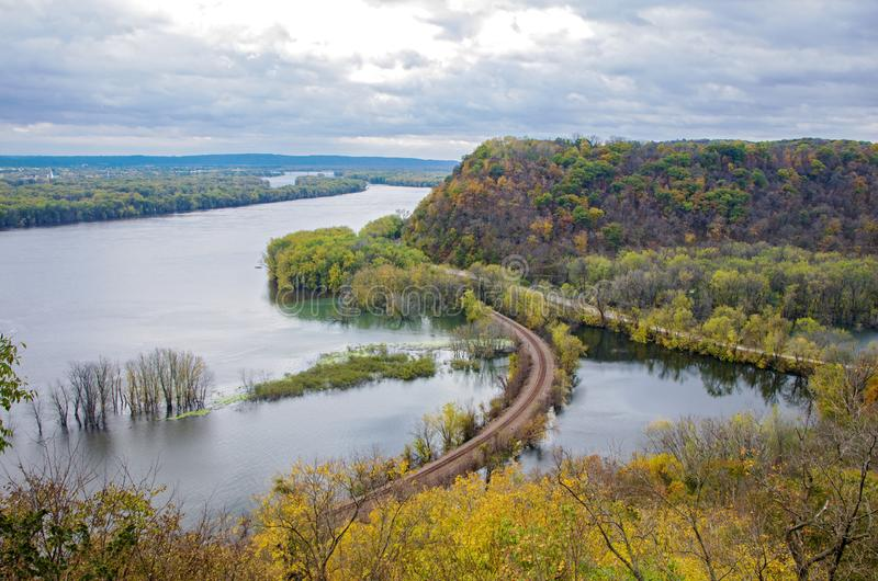 Mississippi River and Wooded Bluffs at Iowa Border. Above mississippi river and woodlands during autumn at iowa border and wisconsin in distance royalty free stock images