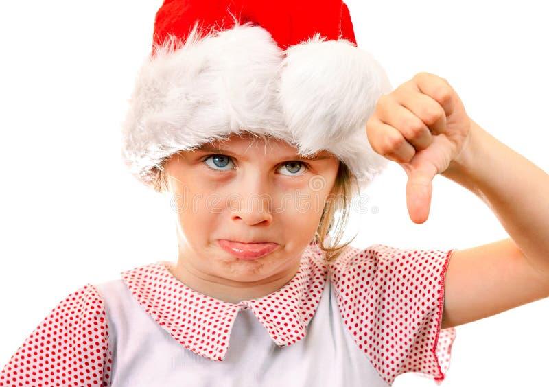 Missnöjd flicka i Santa Hat royaltyfri foto