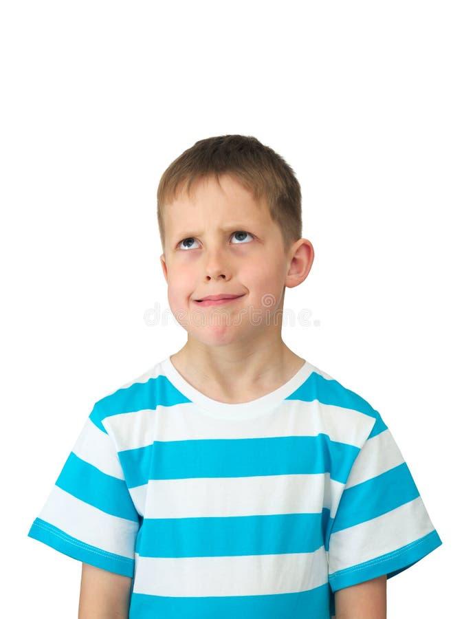 missnöjda ögon för pojke little som är hoprullad vad royaltyfria foton