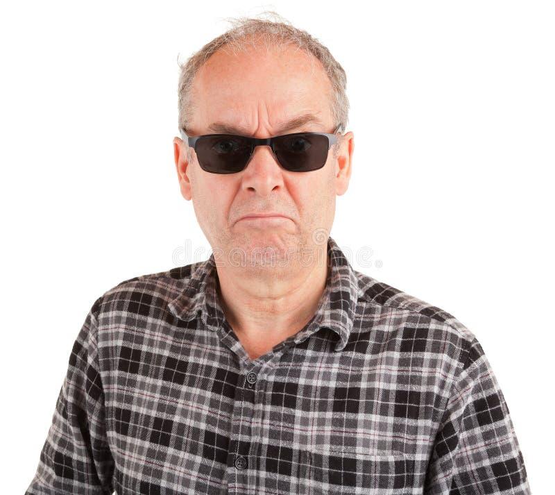 Missnöjda Guy Wearing Sunglasses royaltyfri bild