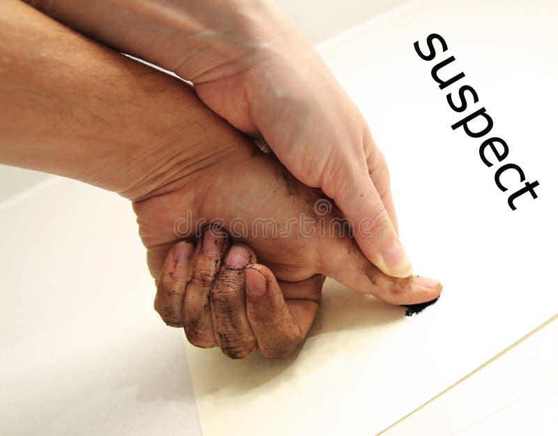 Misstänkt fingeravtryck arkivbild