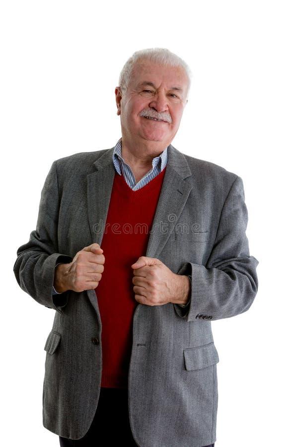 Misstrauischer älterer Mann, der skeptisch schaut lizenzfreies stockfoto